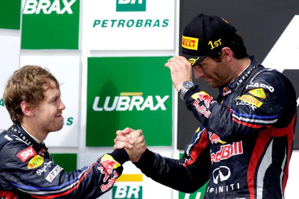 Interlagos, Sao Paulo, Brazil.27th November 2011.Sebastian Vettel, Red Bull Racing RB7 Renault, 2nd position, with Mark Webber, Red Bull Racing RB7 Renault, 1st position. Portrait. Podium. World Copyright:Glenn Dunbar /LAT Photographicref: Digital Image _G7C0024