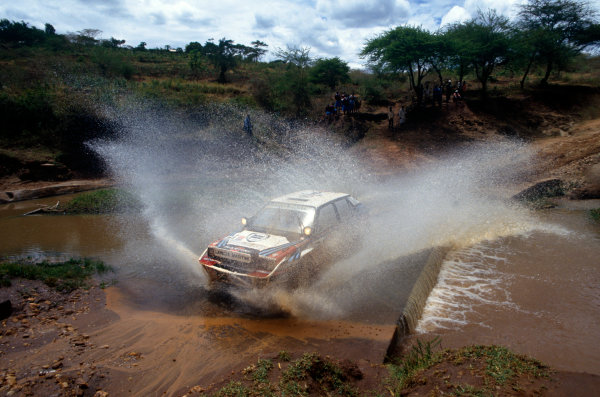 Safari Rally, Kenya. 27 March-1 April 1991.Juha Kankkunen/Juha Piironen (Lancia Delta Integrale 16V), 1st position, action.World Copyright: LAT Photographic.Ref: Colour Transparency.