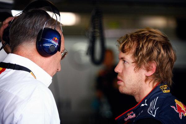 Sebastian Vettel (GER) Red Bull Racing with Pirelli engineer. Formula One Testing, Pirelli Tyre Testing, Yas Marina Circuit, Abu Dhabi, UAE, Friday 19 November 2010.