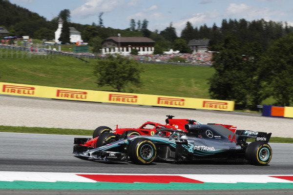 Sebastian Vettel, Ferrari SF71H, battles Lewis Hamilton, Mercedes AMG F1 W09.