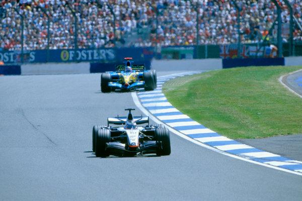 2005 British Grand Prix. Silverstone, England. 8th - 10th July 2005 Juan Pablo Montoya, McLaren Mercedes MP4-20 leads Fernando Alonso, Renault R25. Action. World Copyright: PICME/LAT Photographic Ref: 35mm Image A14