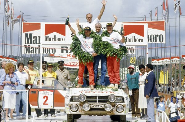 1986 World Rally Championship.Safari Rally, Kenya. 29 March-2 April 1986.Bjorn Waldegaard/Fred Gallagher (Toyota Celica TCT), 1st position. On the podium with Henry Liddon and Ove Andersson.World Copyright: LAT PhotographicRef: 35mm transparency 86RALLY24