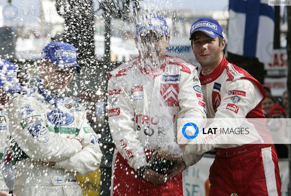 2005 FIA World Rally Champs. Round fourteenRallye De France.20th-23rd October 2005.Sebastien Loeb & Daniel Elena, Citroen, podium.World Copyright: McKlein/LAT