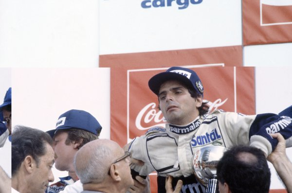 1982 Brazilian Grand Prix.Rio de Janeiro, Brazil. 19-21 March 1982.Nelson Piquet (Brabham BT49D-Ford Cosworth) suffers from heat exhaustion on the podium. He and Keke Rosberg (left, Williams FW07C-Ford Cosworth) were subsequently disqualified for having underweight cars.World Copyright: LAT PhotographicRef: 35mm transparency 82BRA34