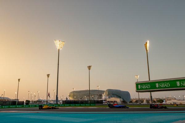 Yas Marina Circuit, Abu Dhabi, United Arab Emirates. Sunday 27 November 2016. Carlos Sainz Jr, Toro Rosso STR11 Ferrari, leads Pascal Wehrlein, Manor MRT 05 Mercedes, and Kevin Magnussen, Renault RE16. World Copyright: Zak Mauger/LAT Photographic ref: Digital Image _X0W9123