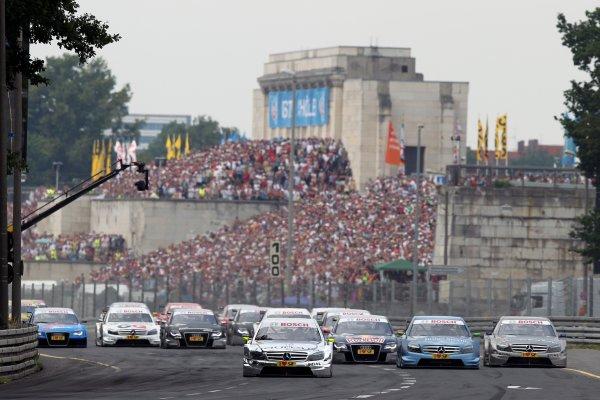 The start of the race, Ralf Schumacher (GER), Laureus AMG Mercedes C-Klasse (2009) leads Jamie Green (GBR), Junge Sterne AMG Mercedes C-Klasse (2008) and Bruno Spengler (CDN), Mercedes-Benz Bank AMG C-Klasse (2009).DTM, Rd4, Norisring, Nuremberg, Germany. 2-4 July 2010 World Copyright: LAT PhotographicRef: Digital Image dne1004jy501