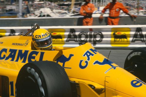 1987 Monaco Grand Prix. Monte Carlo, Monaco. 28th - 31st May 1987.  Ayrton Senna (Lotus 99T Honda),1st position, action. World Copyright: LAT Photographic. Ref: 87MONb