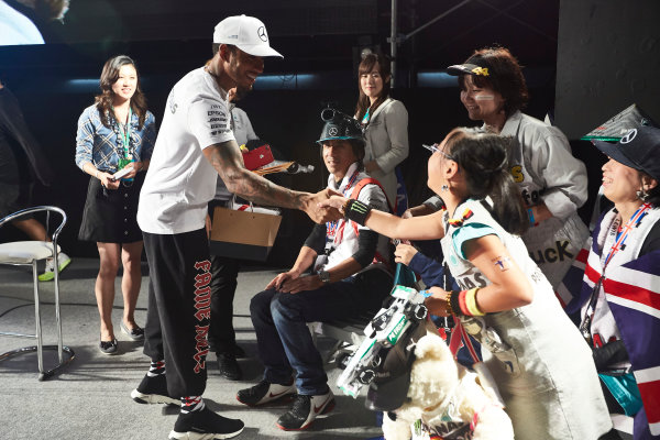 Suzuka Circuit, Japan. Saturday 7 October 2017. Lewis Hamilton, Mercedes AMG, with fans on stage. World Copyright: Steve Etherington/LAT Images  ref: Digital Image SNE14229