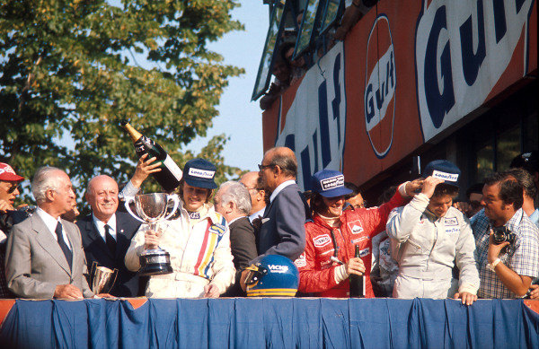 1974 Italian Grand Prix.Monza, Italy.6-8 September 1974.Ronnie Peterson (Lotus Ford) 1st position, Emerson Fittipaldi (McLaren Ford) 2nd position and Jody Scheckter (Tyrrell Ford) 3rd position on the podium. Ref-74 ITA 02.World Copyright - LAT Photographic