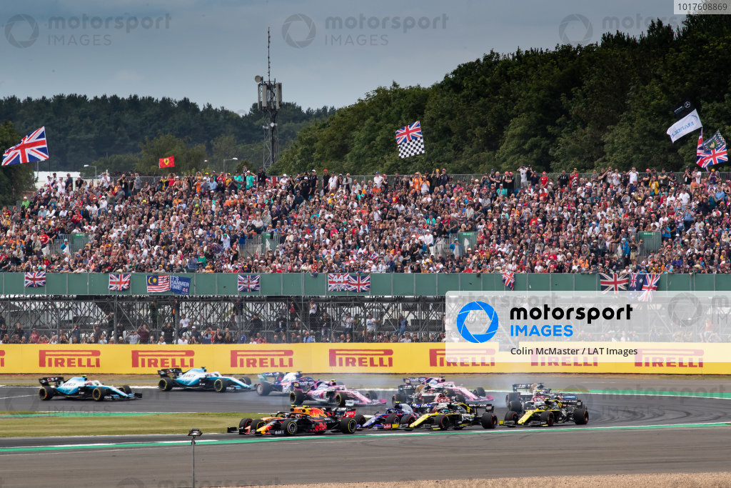 Pierre Gasly, Red Bull Racing RB15, battles with Lando Norris, McLaren MCL34, at the start of the race