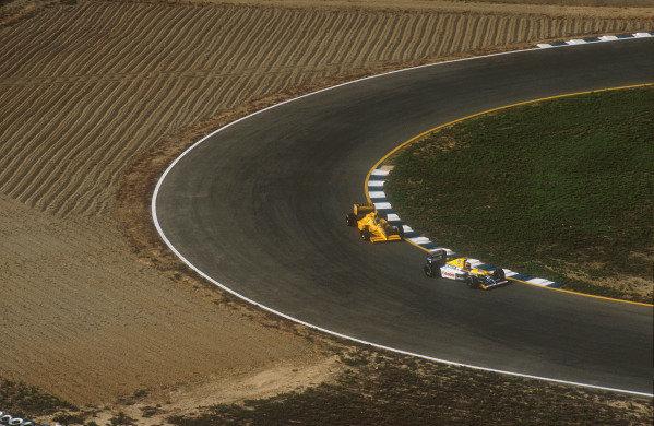 1990 Spanish Grand Prix.Jerez, Spain.28-30 September 1990.Thierry Boutsen (Williams FW13B Renault) followed by Derek Warwick (Lotus 102 Lamborghini).Ref-90 ESP 12.World Copyright - LAT Photographic