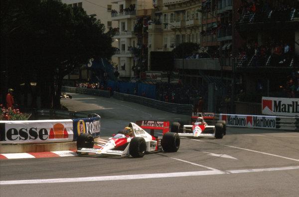 Monte Carlo, Monaco.4-7 May 1989.Ayrton Senna (McLaren MP4/5 Honda) 1st position leads teammate Alain Prost (McLaren MP4/5 Honda) through Ste. Devote.Ref-89 MON 07.World Copyright - LAT Photographic