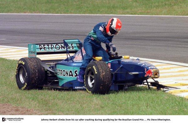 1998 Brazilian Grand Prix.Interlagos, Sao Paulo, Brazil.27-29 March 1998.Johnny Herbert (Sauber C17 Petronas Ferrari) climbs from his car after crashing during qualifying.World Copyright - Steve Etherington/LAT Photographic