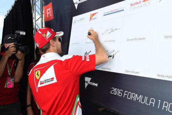 Sebastian Vettel (GER) Ferrari signs the autograph wall at Formula One World Championship, Rd1, Australian Grand Prix, Preparations, Albert Park, Melbourne, Australia, Thursday 17 March 2016.