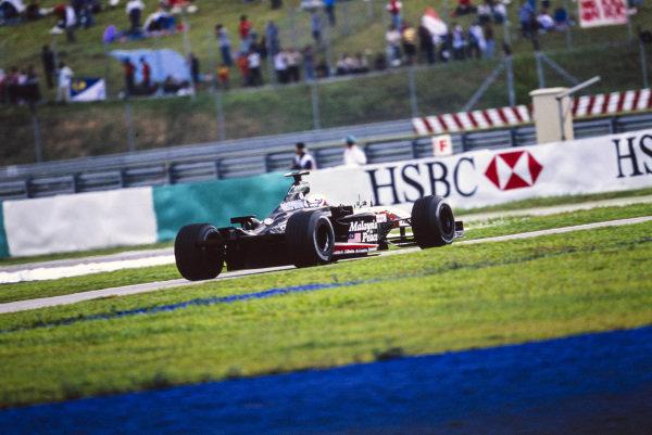 Jos Verstappen, Minardi PS03 Cosworth, missing a rear wing.