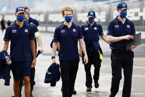 Tom Blomqvist (GBR), NIO 333, and Oliver Turvey (GBR), NIO 333, walk the track with members of their team