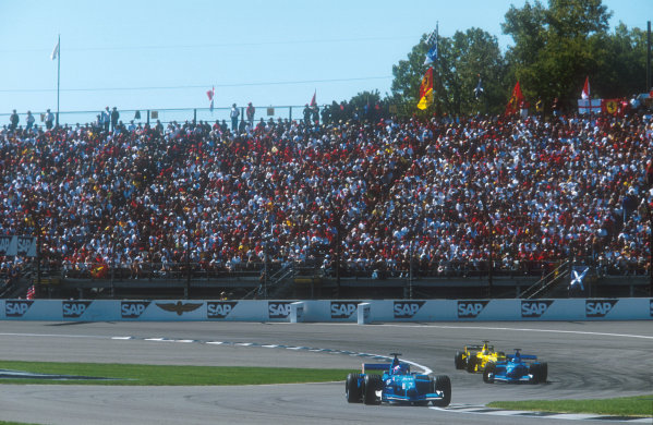 2001 United States Grand Prix.Indianapolis, Indiana, USA.28-30 September 2001.Jenson Button heads teammate Giancarlo Fisichella (both Benetton B201 Renault's) and Jean Alesi (Jordan EJ11 Honda). They finished in 8th, 7th and 6th positions respectively.Ref-01 USA 17.World Copyright - LAT Photographic