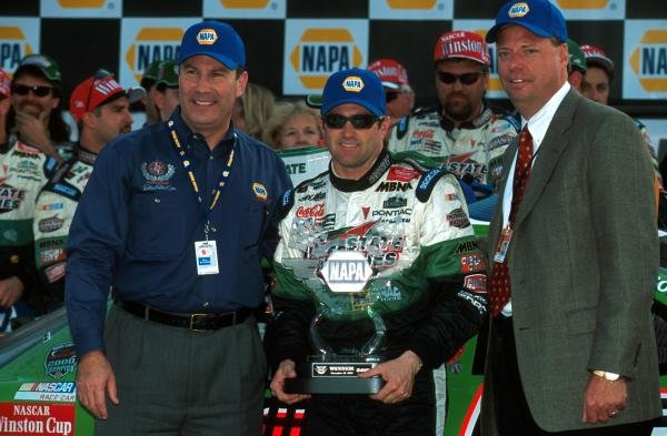 Race winner Bobby Labonte (USA) stands in Victory Lane with his trophy.