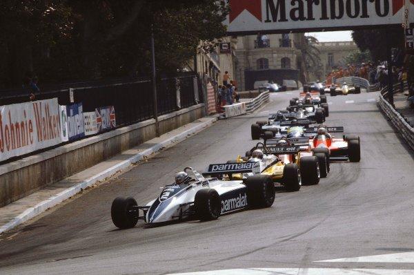 1982 Monaco Grand Prix.Monte Carlo, Monaco.21-23 May 1982.Riccardo Patrese (Brabham BT49D Ford) leads Alain Prost (Renault RE30B), Didier Pironi (Ferrari 126C2) and Andre de Cesaris (Alfa Romeo 182) into Mirabeau.Ref-82 MON 18.World Copyright - LAT Photographic