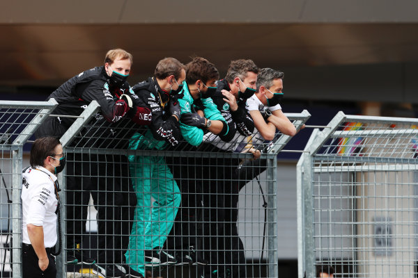 Mercedes team-mates wait on the pit wall fence for winner Lewis Hamilton, Mercedes F1 W11 EQ Performance