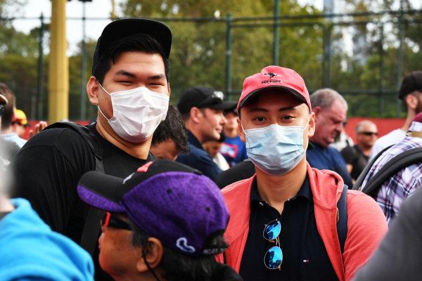 Fans wear protective masks in light of the coronavirus outbreak