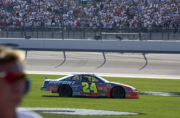 2002 NASCAR,Kansas City,Ks. Sept 26-29, 2002 USA -Jeff Gordon spinning thru the grass after win,Copyright-Robt LeSieur2002LAT Photographic