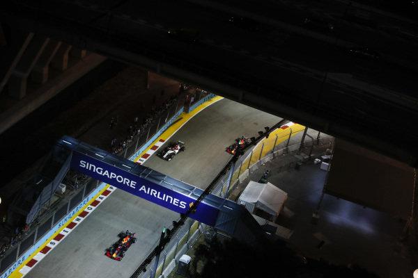 Alexander Albon, Red Bull RB15, leads Kimi Raikkonen, Alfa Romeo Racing C38 and Max Verstappen, Red Bull Racing RB15