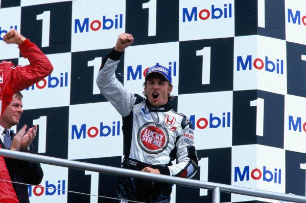 2004 German Grand PrixHockenheim, Germany. 23rd - 25th July.Jenson Button, BAR Honda 006 celebrates his second position on the podium.World Copyright:Lorenzo Bellanca/LAT Photographic Ref:35mm Image:A22
