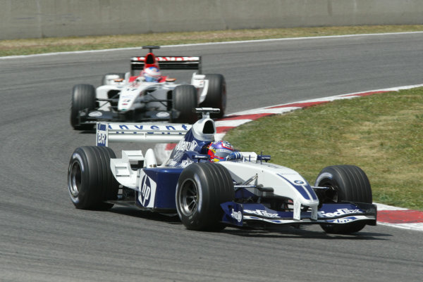 2003 Spanish Grand Prix - Sunday Race,Barcelona, Spain.4th May 2003.Juan-Pablo Montoya, BMW Williams FW24, leads Jenson Button, B-A-R Honda 005, action.World Copyright LAT Photographic.ref: Digital Image Only.