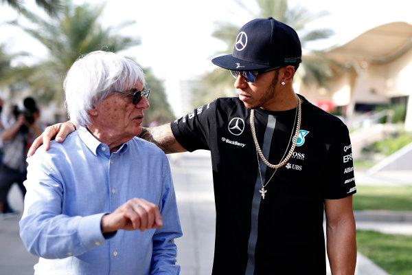 Bahrain International Circuit, Sakhir, Bahrain. Thursday 16 April 2015. Bernie Ecclestone, CEO and President, FOM and Lewis Hamilton, Mercedes AMG.  World Copyright: Glenn Dunbar/LAT Photographic. ref: Digital Image _W2Q6378