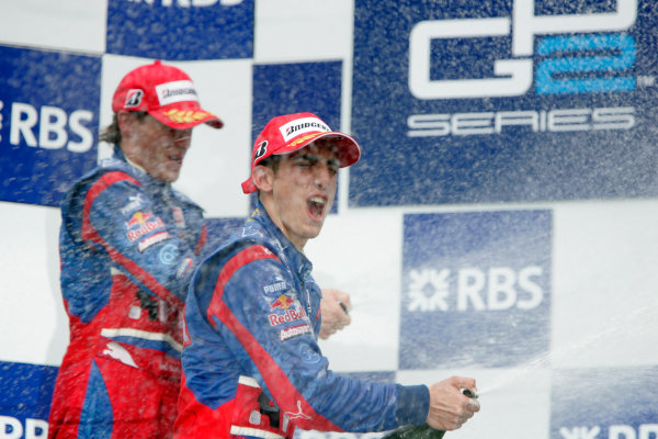 Magny-Cours, France. 22nd June.Sunday Race. Sebastien Buemi (SUI, Trust Team Arden) celebrates his victory on the podium with Yelmer Buurman (NED, Trust Team Arden). World Copyright: Alastair Staley/GP2 Series Media Service.ref: Digital Image _MG_3564