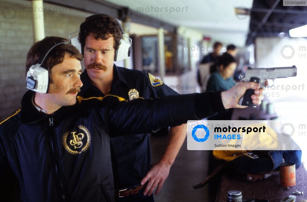 Nigel Mansell (GBR) Lotus practices shooting with the local Police.Formula One World Championship, Rd3, USA West Grand Prix, Long Beach, USA, 4 April 1982.