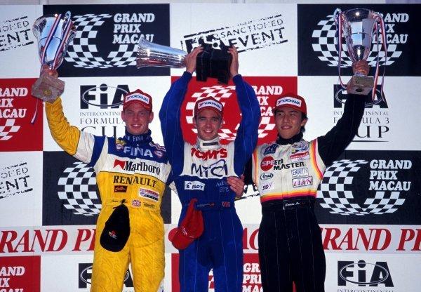 (L-R): Jenson Button (GBR) Promatecme 2nd, race winner Darren Manning (GBR) TOM'S and Daisuke Itoh (JPN) 3rd on the podium. Macau Formula 3 Grand Prix, Macau, Hong Kong, 21 November 1999. BEST IMAGE