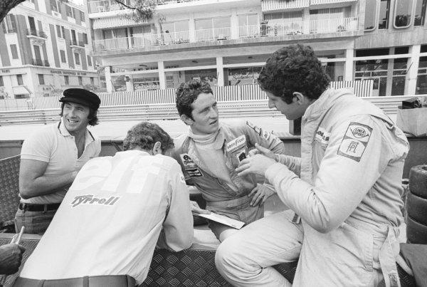 Patrick Depailler (FRA) Tyrrell, and Jody Scheckter (RSA) Tyrrell. Jackie Stewart (GBR), far left, enjoys a joke.Monaco Grand Prix, Rd6, Monte Carlo, Monaco, 30 May 1976.