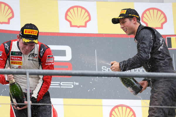 2013 GP3 Series. Round 6.  Spa - Francorchamps, Spa, Belgium. 25th August. Sunday Race. Alexander Sims (GBR, Carlin) celebrates his victory on the podium.  World Copyright: Alastair Staley/GP3 Media Service. ref: Digital Image _R6T8350.jpg