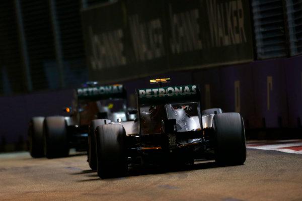 Marina Bay Circuit, Singapore. Sunday 22nd September 2013.  Lewis Hamilton, Mercedes W04, follows Nico Rosberg, Mercedes W04.  World Copyright: Charles Coates/LAT Photographic. ref: Digital Image _N7T7718