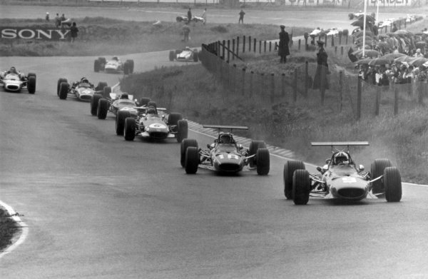 1968 Dutch Grand Prix.Zandvoort, Holland. 23 June 1968.Chris Amon, Ferrari 312, 6th position, leads Jacky Ickx, Ferrari 312, 4th position, Jochen Rindt, Brabham BT26-Repco, retired, Jo Siffert, Lotus 49-Ford, retired, Pedro Rodriguez, BRM P133, 3rd position, Jean-Pierre Beltoise, Matra MS11, 2nd position, Bruce McLaren, McLaren M7A-Ford, retired, and John Surtees, Honda RA301, retired, action.World Copyright: LAT PhotographicRef: Autosport b&w print