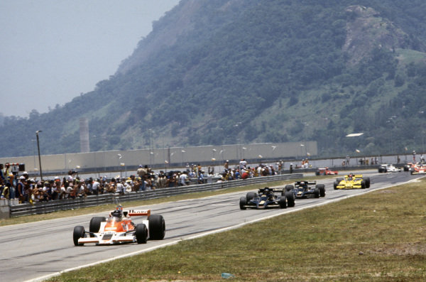 James Hunt, McLaren M26 Ford leads Ronnie Peterson, Lotus 78 Ford and Mario Andretti, Lotus 78 Ford.