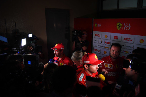Sebastian Vettel, Ferrari, and Charles Leclerc, Ferrari, talk to the media.