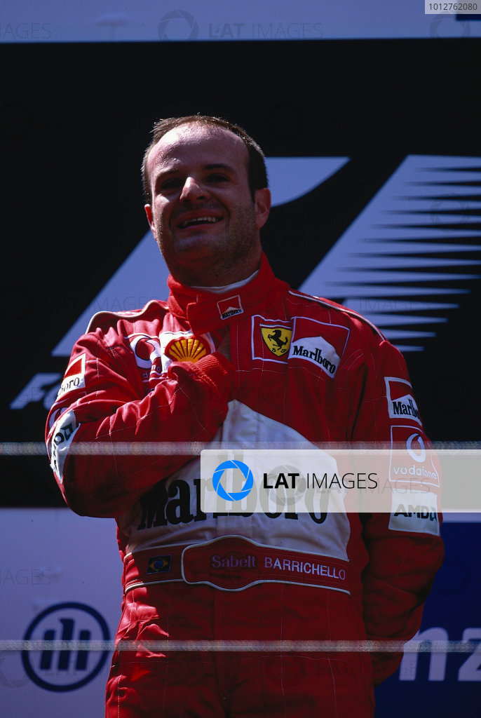 2002 European Grand Prix, Nurburgring, Germany. 23rd June 2002 Rubens Barrichello,winner of the European GP takes the top step of the podium for the Brazilian National anthem.World Copyright: LAT PhotographicRef: 35mm transparency