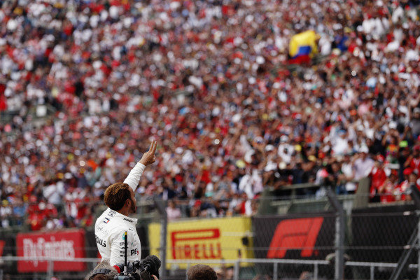 Lewis Hamilton, Mercedes AMG F1, celebrates with the fans as he celebrates winning his fifth World Championship