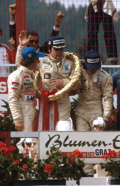 1979 Austrian Grand Prix.Osterreichring, Zeltweg, Austria.10-12 August 1979.Alan Jones (Williams Ford) 1st position, Gilles Villeneuve (Ferrari) 2nd position and Jacques Laffite (Ligier Ford) 3rd position on the podium.Ref-79 AUT 03.World Copyright - LAT Photographic