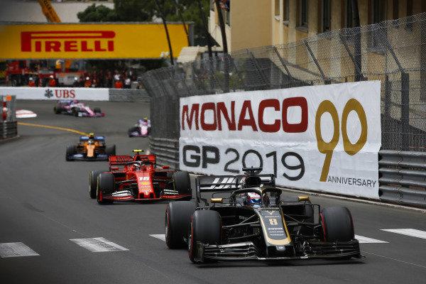 Romain Grosjean, Haas VF-19, leads Charles Leclerc, Ferrari SF90, and Lando Norris, McLaren MCL34