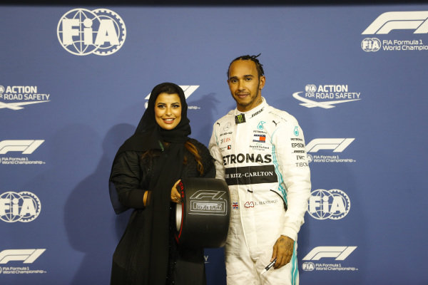 Lewis Hamilton, Mercedes AMG F1, receives the Pirelli Pole Position Trophy from Aseel Al-Hamad