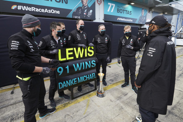 Lewis Hamilton, Mercedes-AMG Petronas F1, 1st position, celebrates with his team after securing his 91st F1 race win, equalling the record of Michael Schumacher