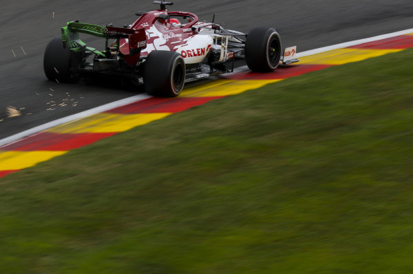 Sparks fly from the car of Kimi Raikkonen, Alfa Romeo Racing C39