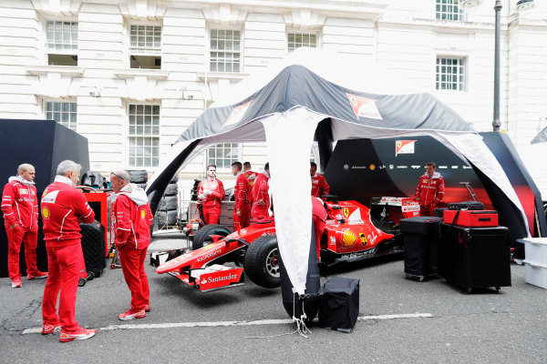 F1 Live London. London, United Kingdom. Wednesday 12 July 2017. The Ferrari team prepare for the London street demonstration. World Copyright: Zak Mauger/LAT Images ref: Digital Image: _56I5444