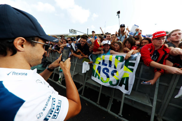 Hungaroring, Budapest, Hungary.  Thursday 27 July 2017. Felipe Massa, Williams Martini Racing, takes a picture of fans. World Copyright: Glenn Dunbar/LAT Images  ref: Digital Image _X4I9205