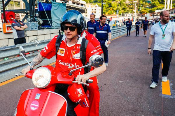 Monte Carlo, Monaco. Wednesday 24 May 2017. Kimi Raikkonen, Ferrari, leaves the pits on a scooter. World Copyright: Sam Bloxham/LAT Images ref: Digital Image _W6I0553