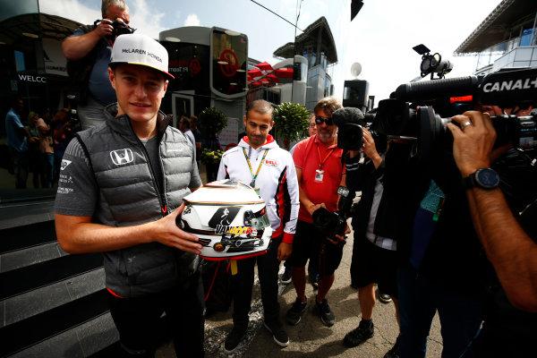 Spa Francorchamps, Belgium.  Thursday 24 August 2017. Stoffel Vandoorne, McLaren, displays a Bell helmet in front of media. World Copyright: Andy Hone/LAT Images  ref: Digital Image _ONZ8221